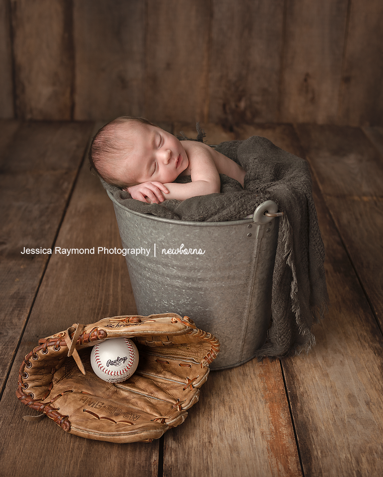 infant photography san marcos california baby pictures in bucket with baseball
