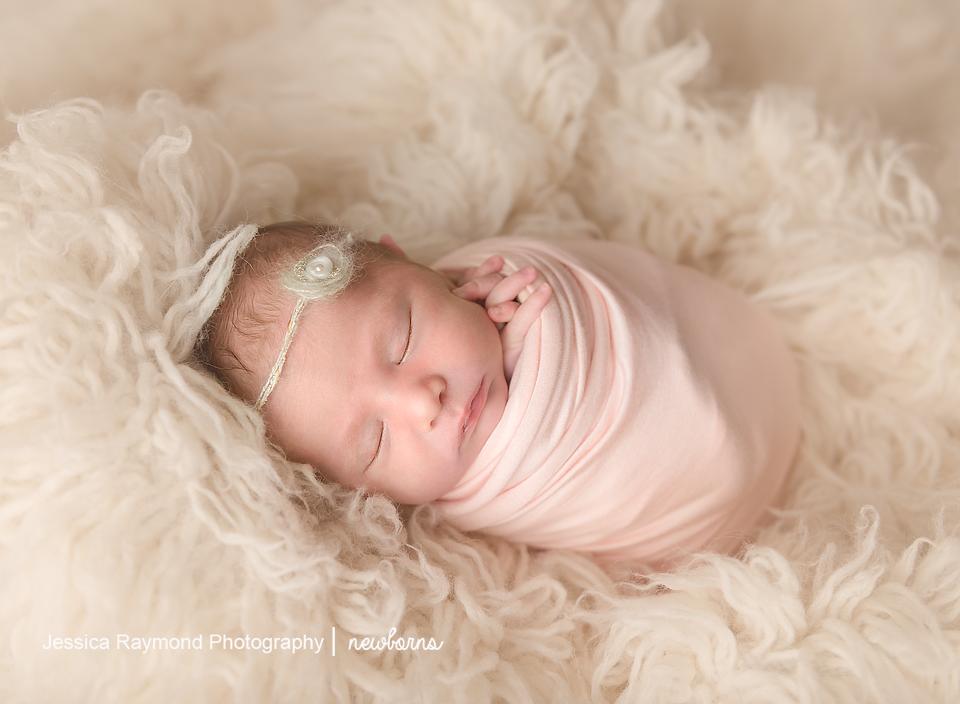 newborn baby photographer san diego california newborn photos baby girl wrapped in pink wrap