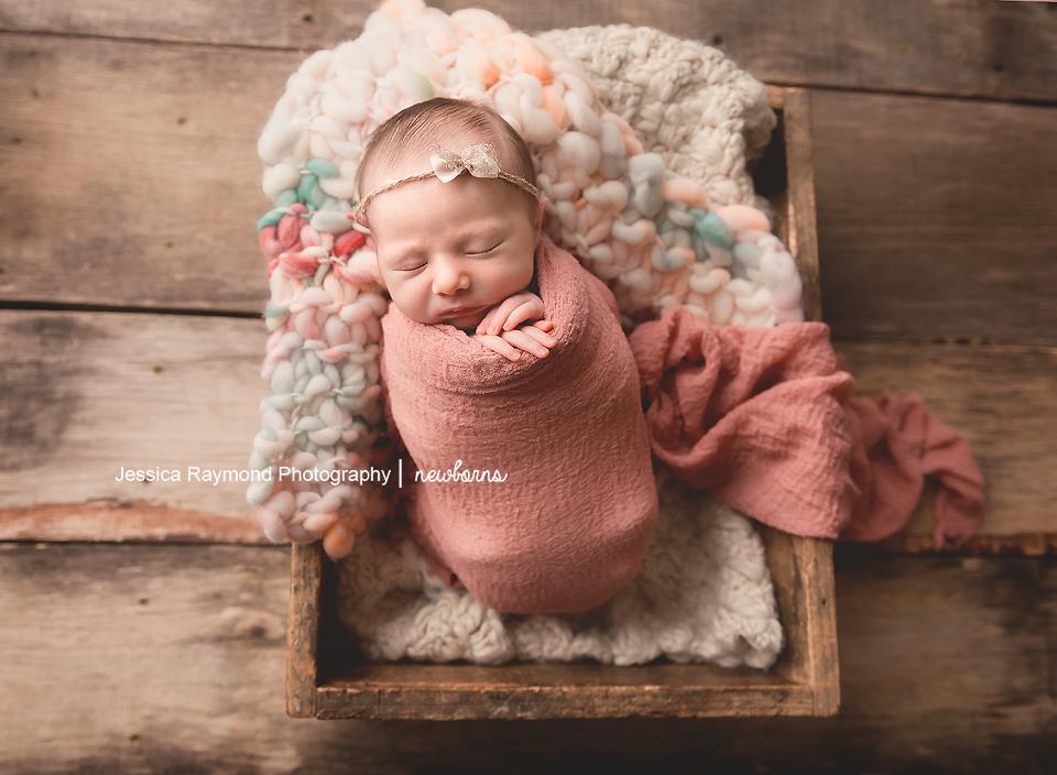 newborn baby photographer san diego california newborn photo shoot baby girl in crate pose