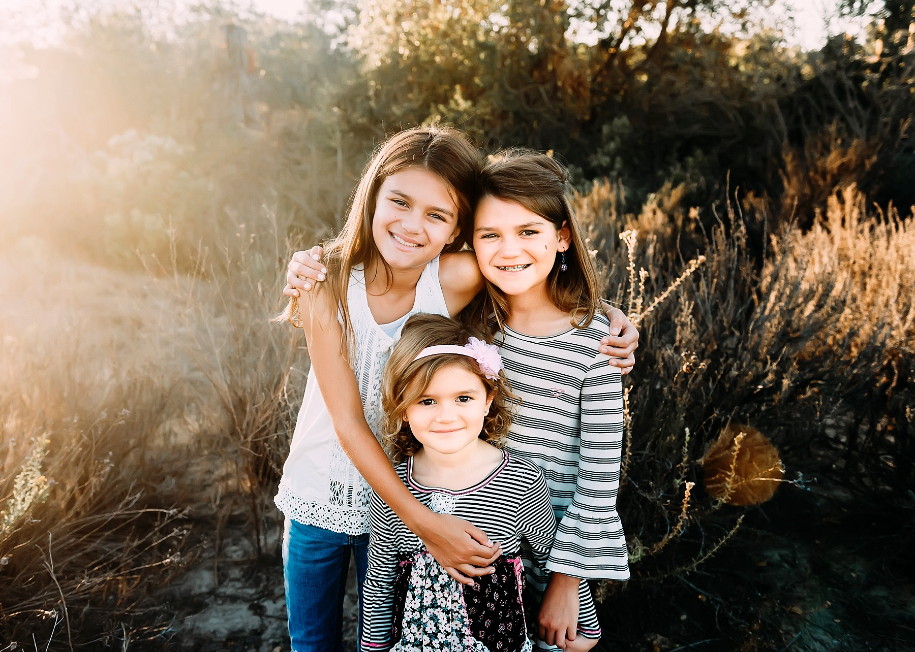 family photography carlsbad sisters pose
