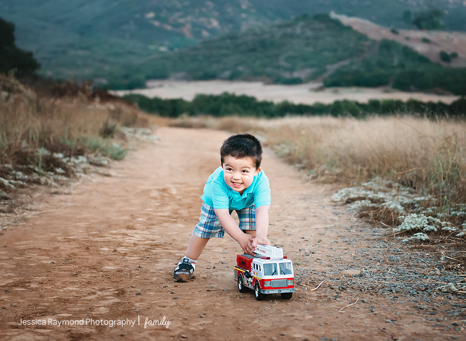 family photography session family portraits family pictures boy with fire truck