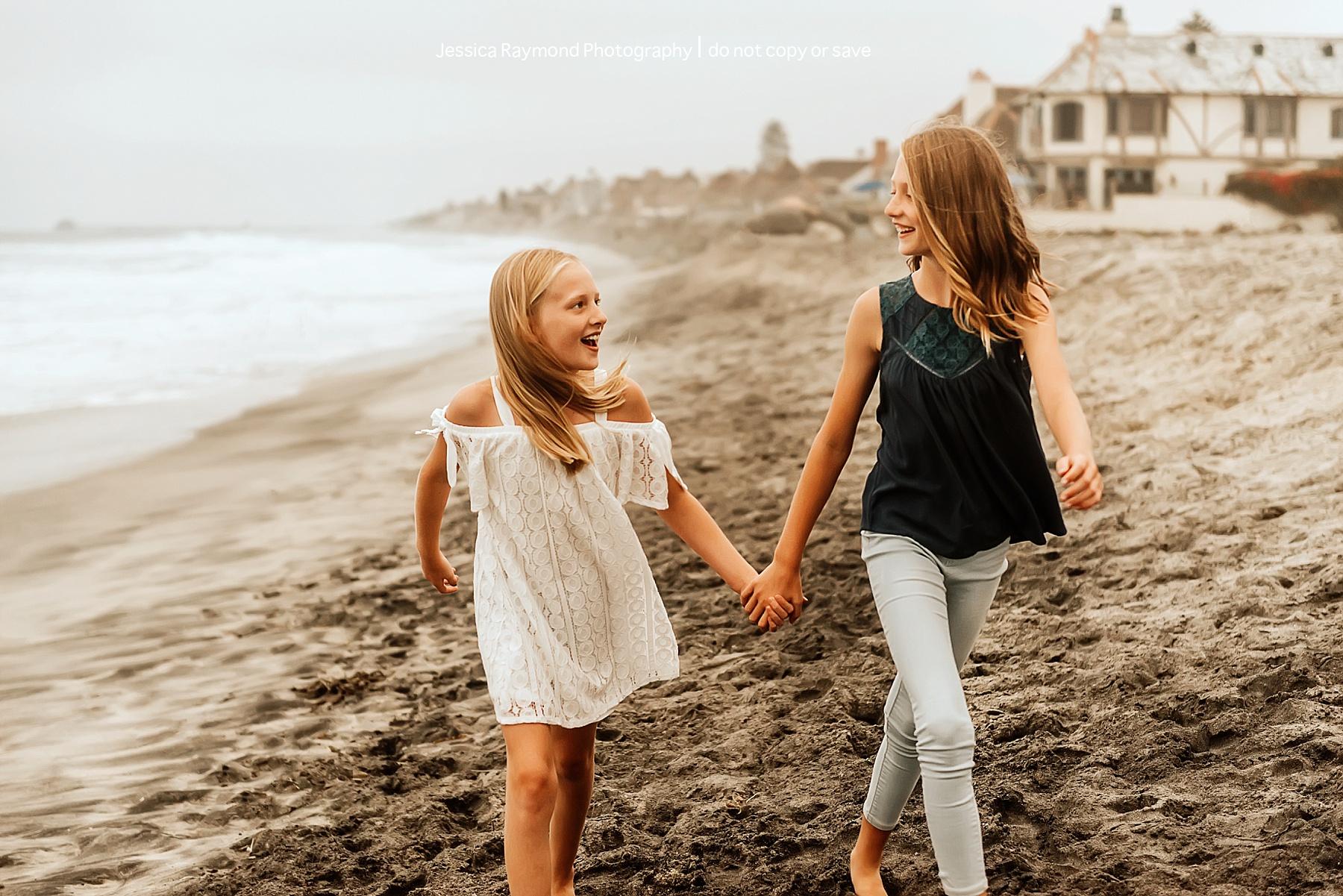 carlsbad beach family photos sisters walking on beach