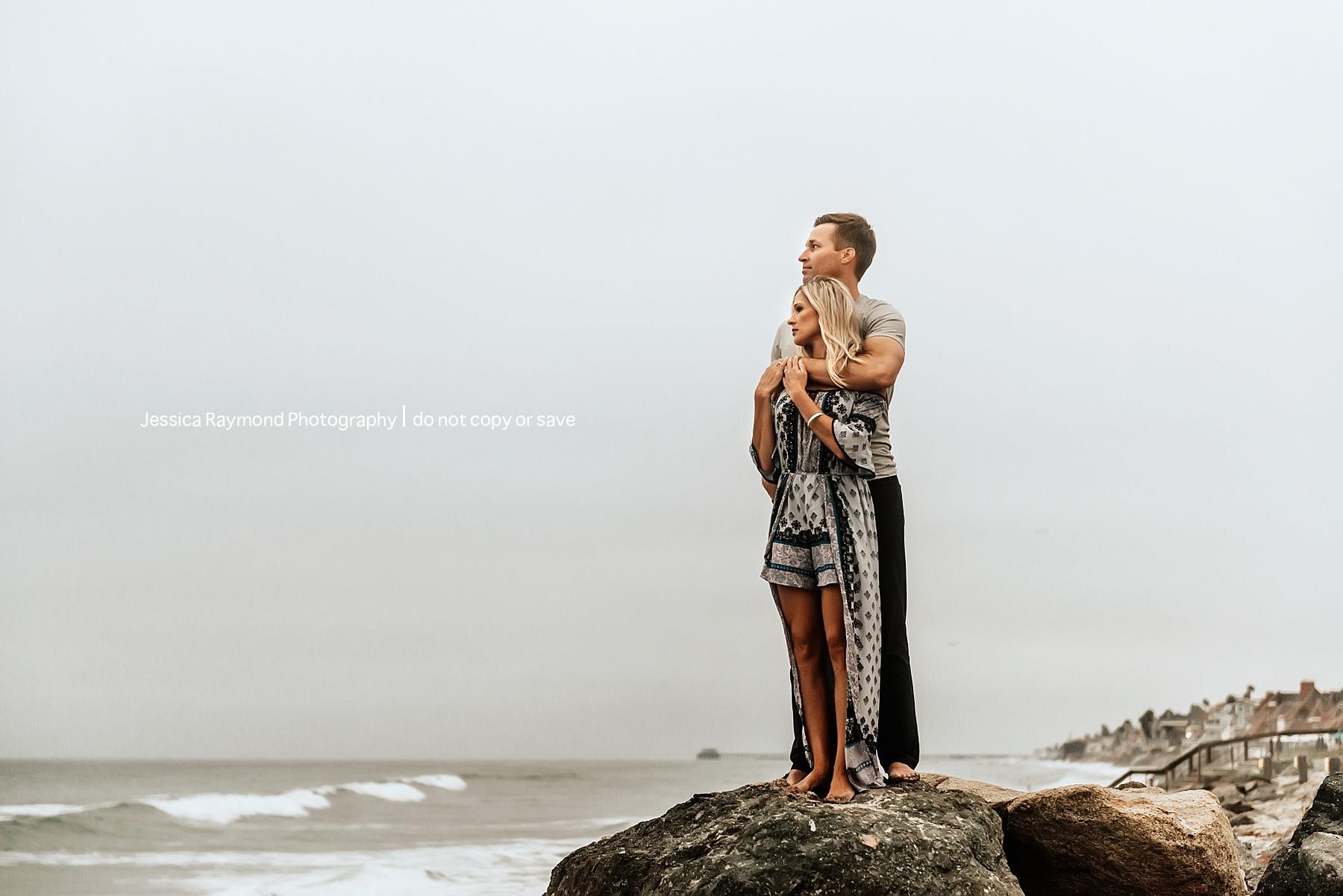 family beach pics beautiful couple pose on rock