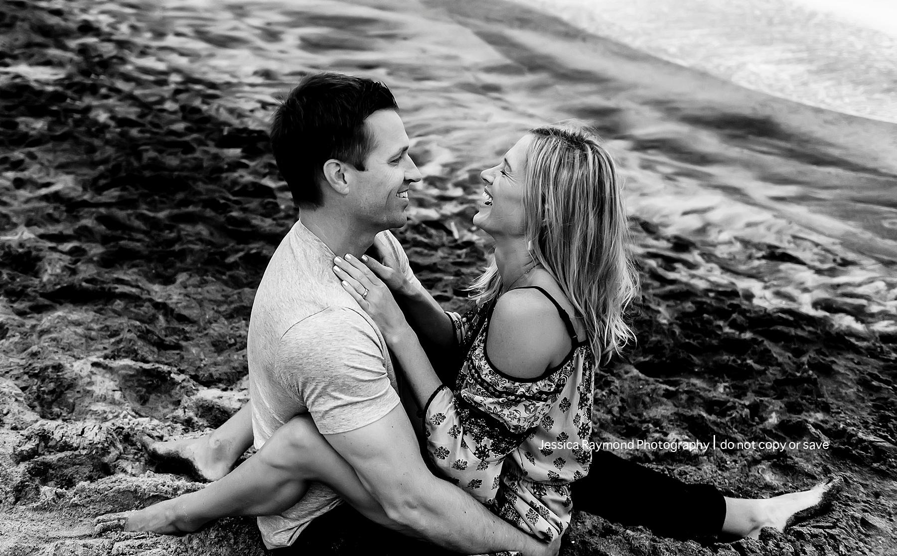 family beach pics fun couple pose black and white