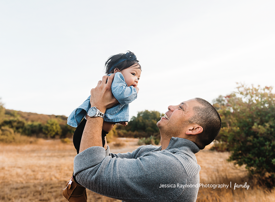 san elijo family photographer family photos family portraits with baby in dad holding baby girl in field