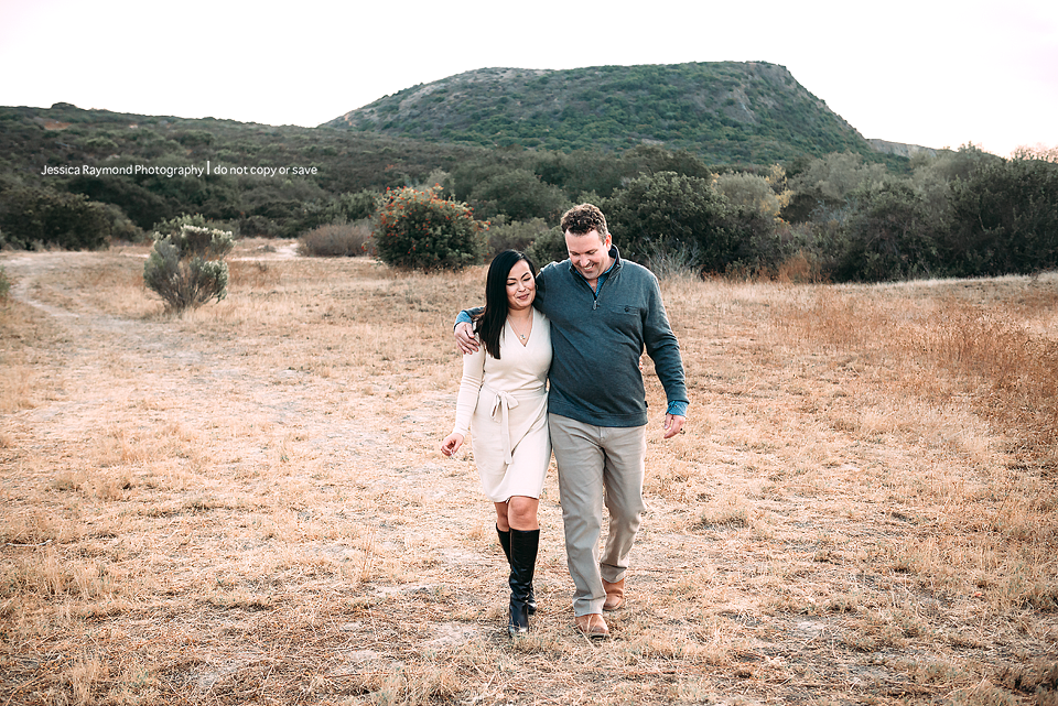 couples photography san diego couples photographer couple walking in field