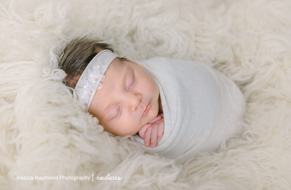 newborn photography pictures baby girl on beanbag