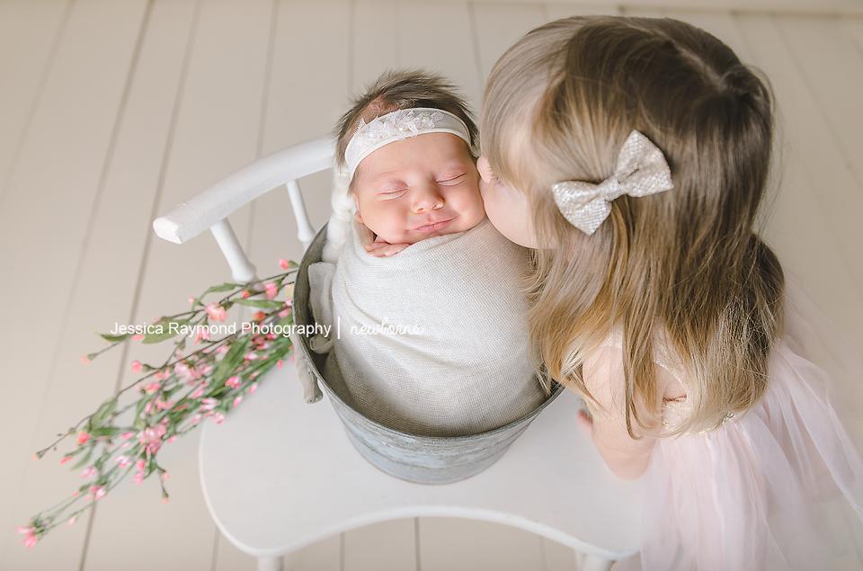 newborn photography san diego baby girl in bucket sibling pose