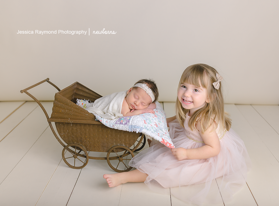 newborn photography san diego baby girl in carriage sibling pose