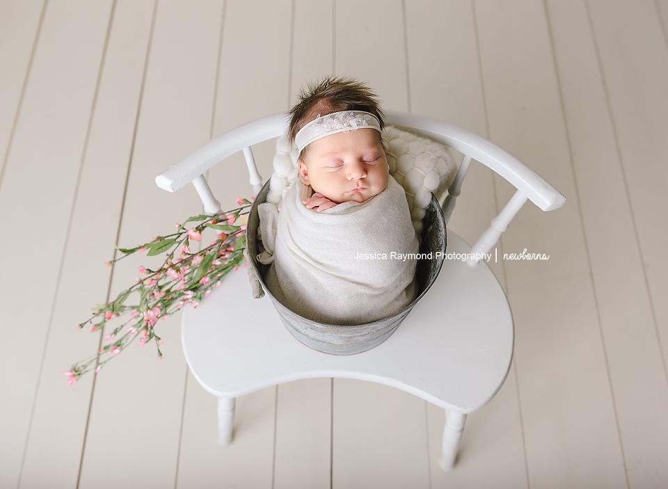 newborn pictures baby girl in bucket flowers