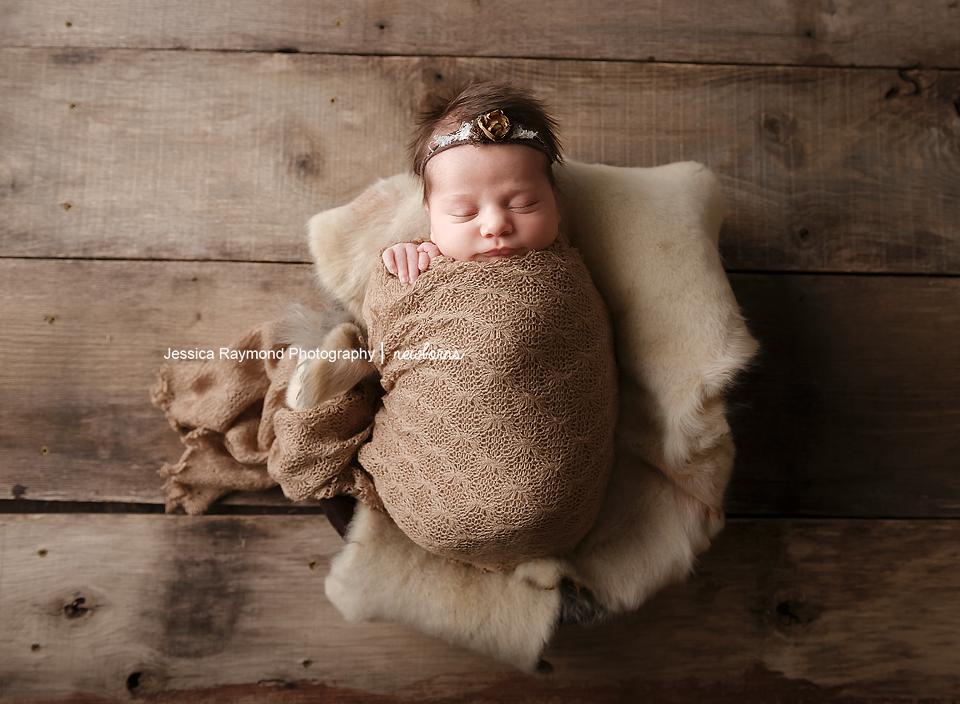 san diego newborn pictures baby girl brown wrap sheepskin