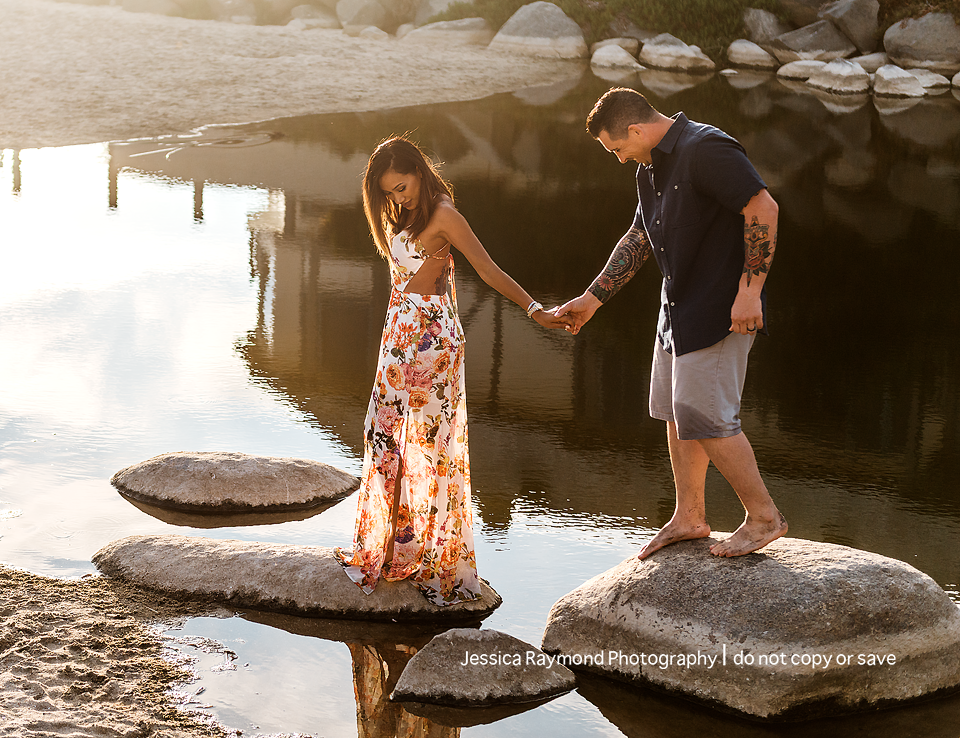 family photography oceanside family photographer couple pose at beach