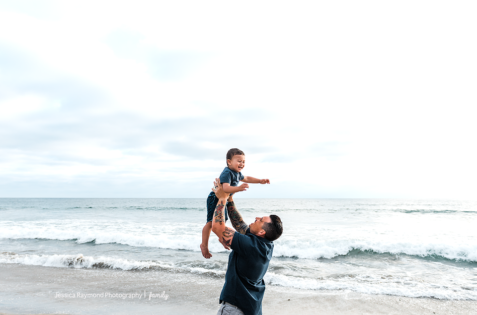 family photography oceanside best family photographer dad playing with son on beach