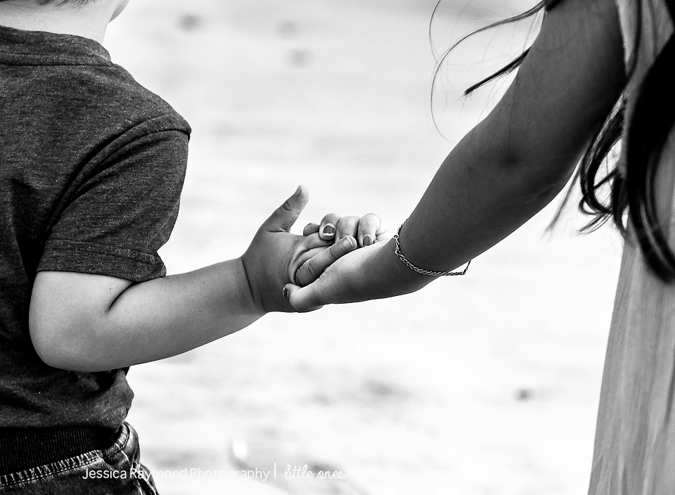 family photography oceanside best family photographer siblings holding hands on beach