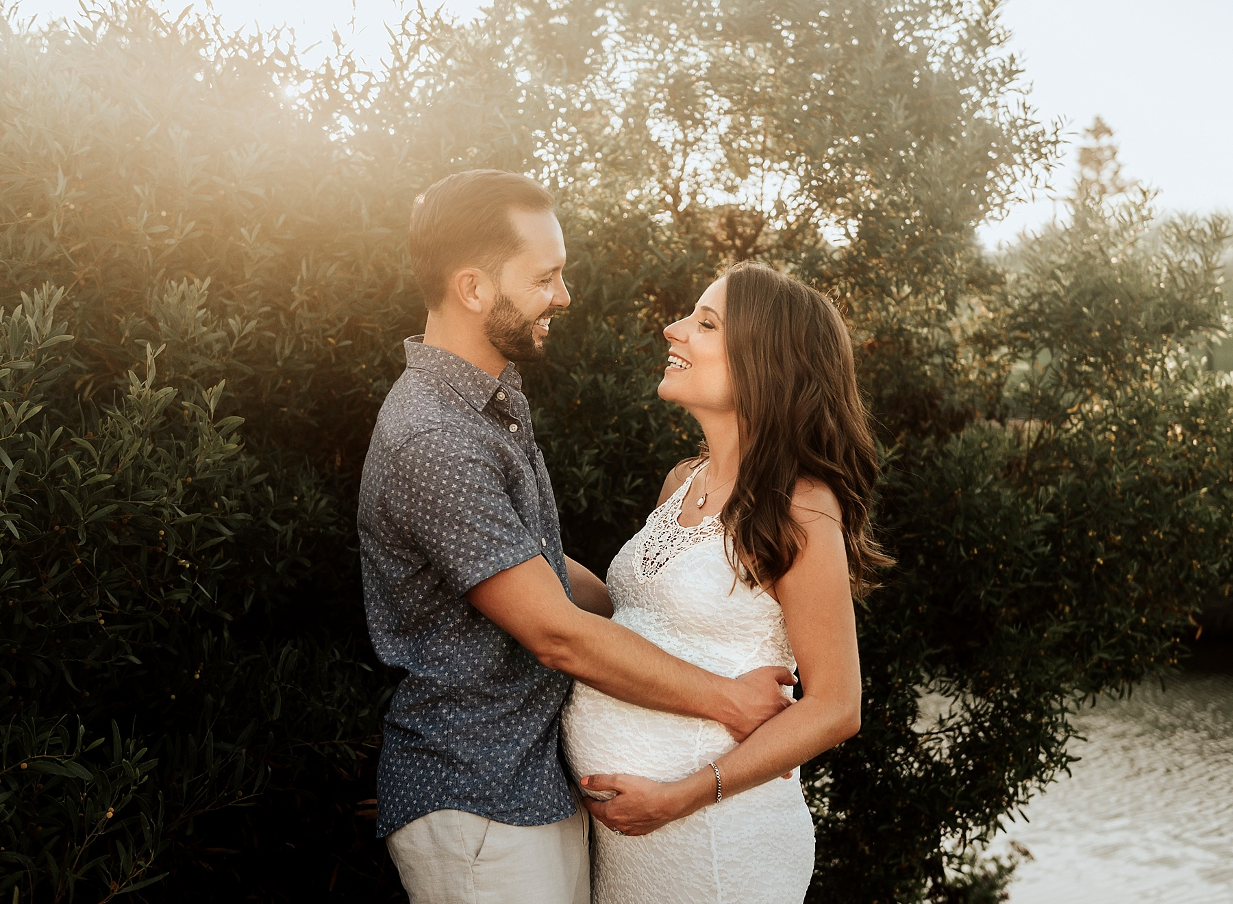 beach maternity pictures carlsbad couple by tree