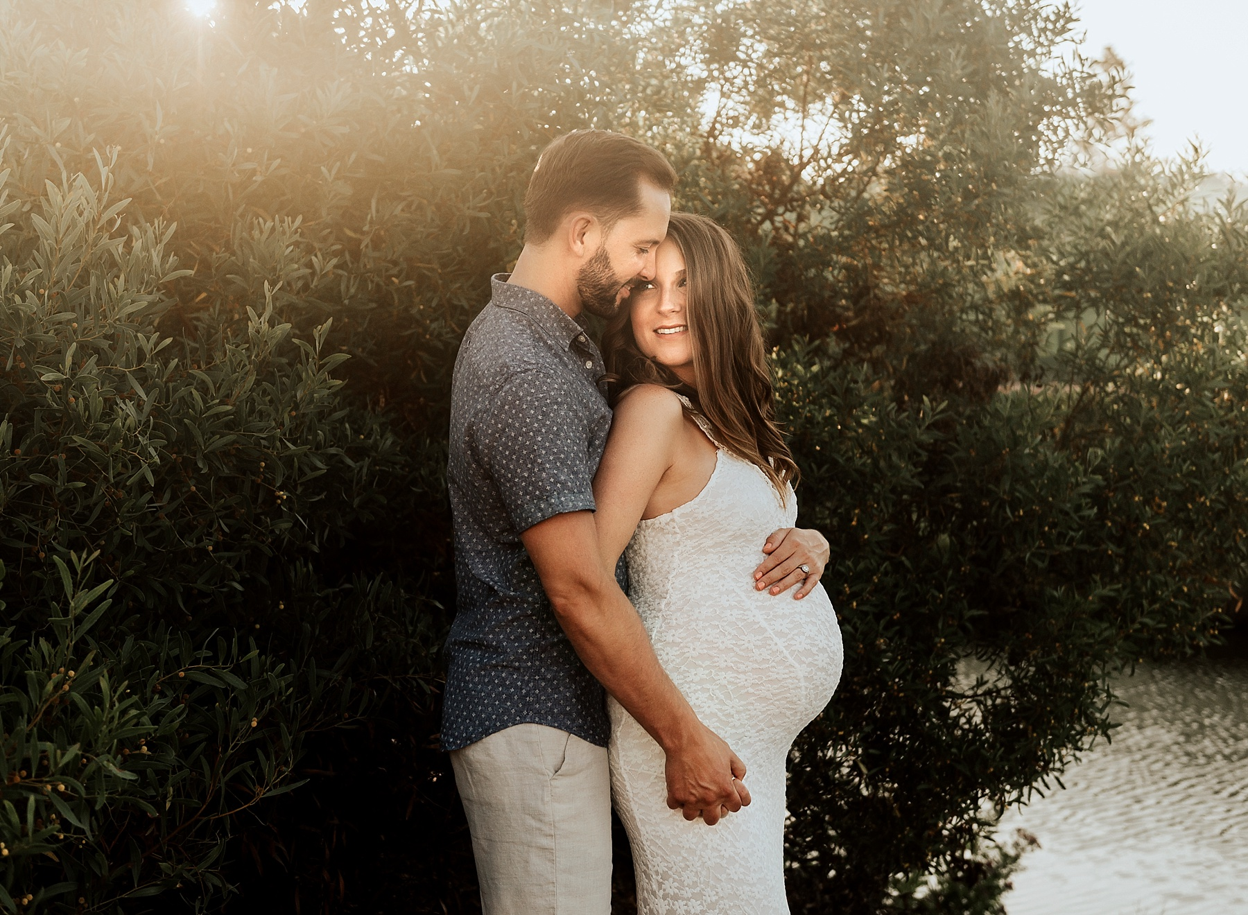 beach maternity pictures carlsbad couple snuggling