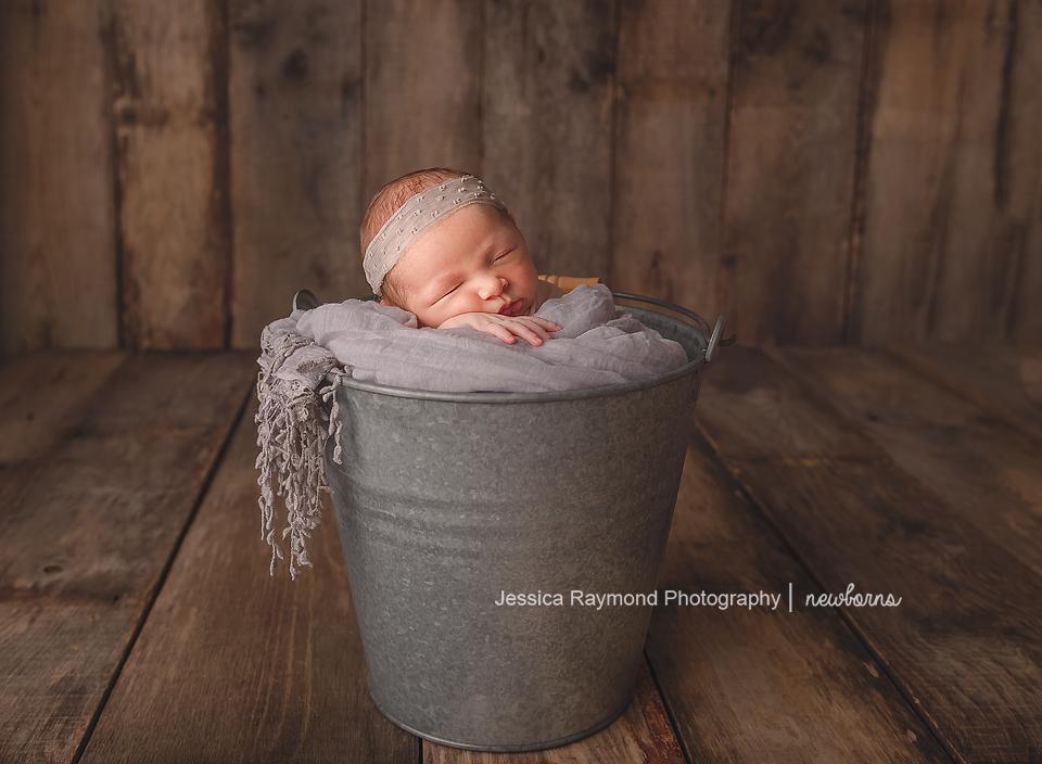 carlsbad baby photographer newborn family session newborn photo shoot baby girl in bucket