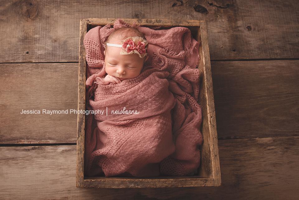 carlsbad baby photographer newborn family session newborn photo shoot baby girl in pink wrap in box