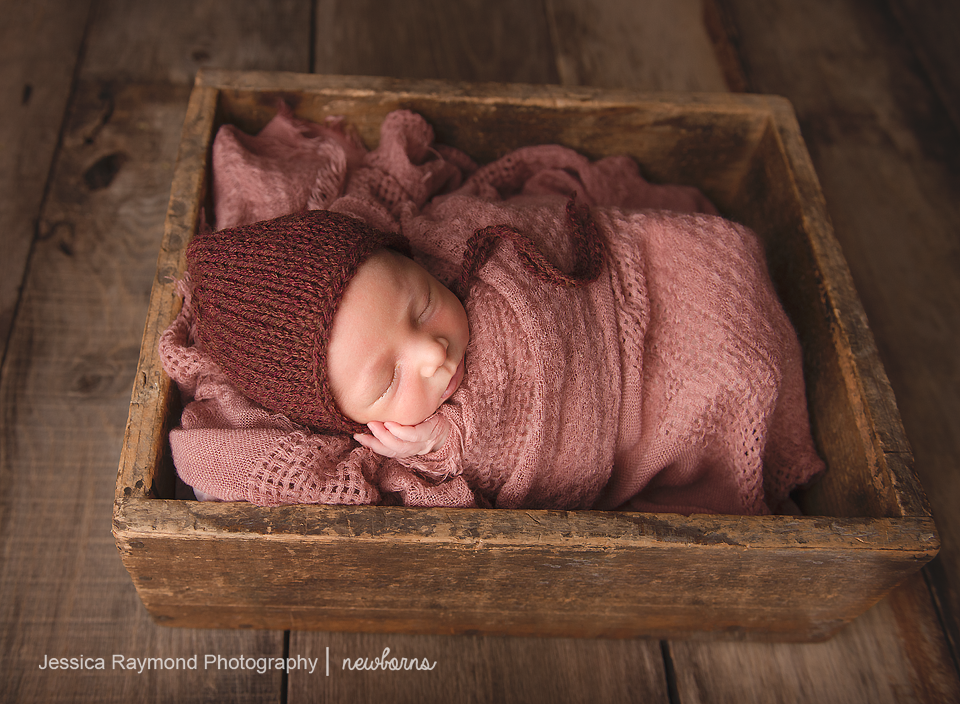 carlsbad baby photographer newborn family session newborn photo shoot baby girl in pink wrap and bonnet