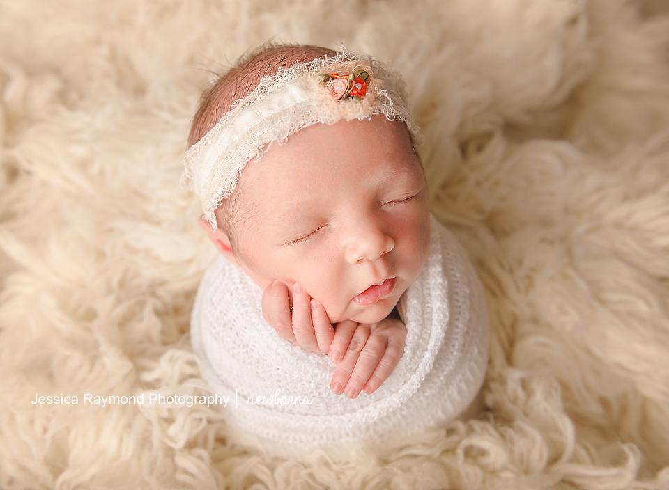 carlsbad baby photographer newborn family session newborn photo shoot baby girl in potato sack pose