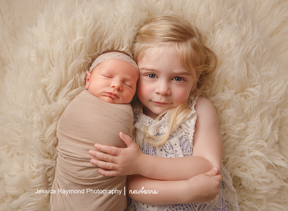 carlsbad baby photographer newborn family session newborn photo shoot baby pictures sisters pose