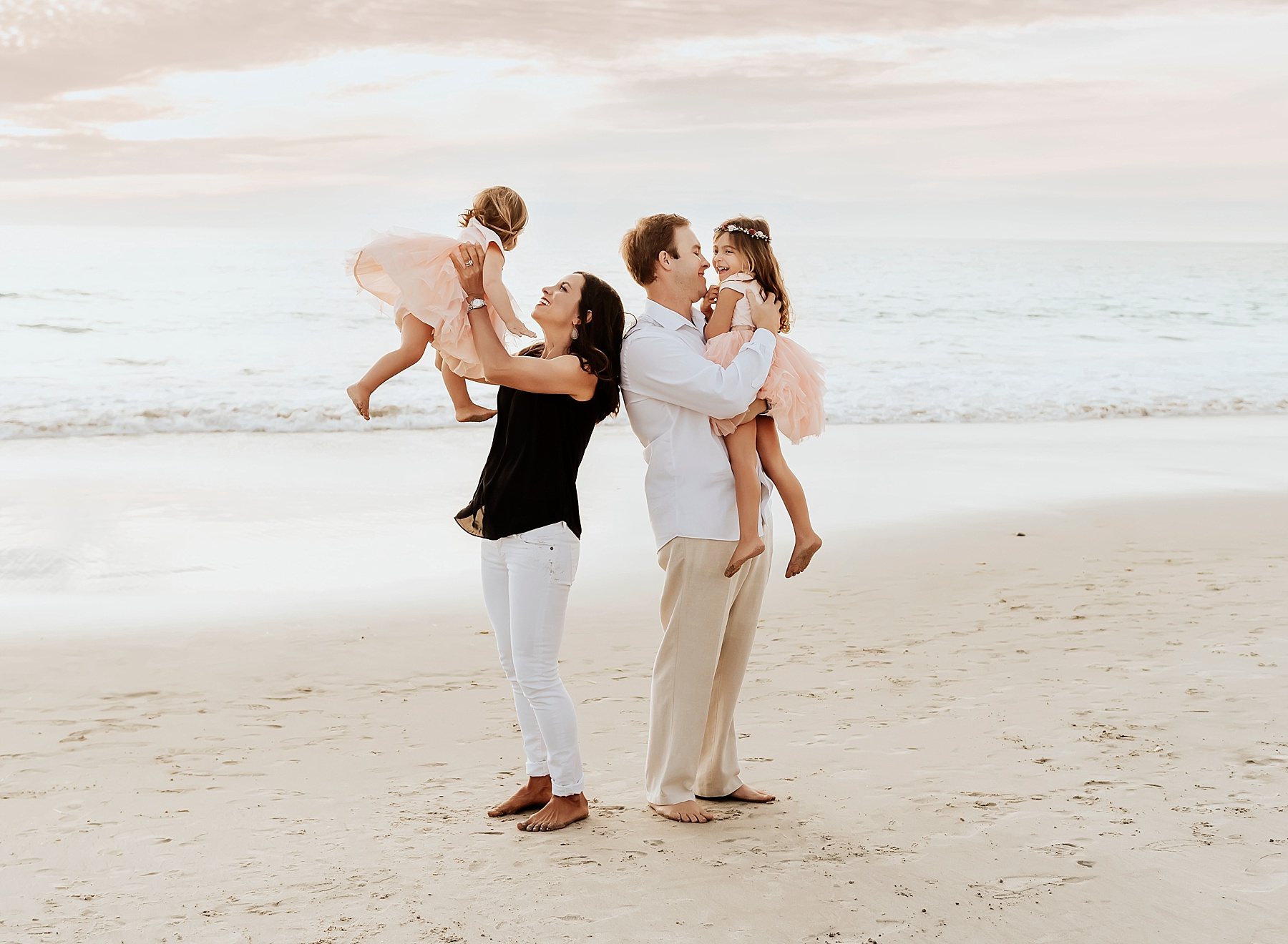 family beach portrait photography family of 4 beach pictures