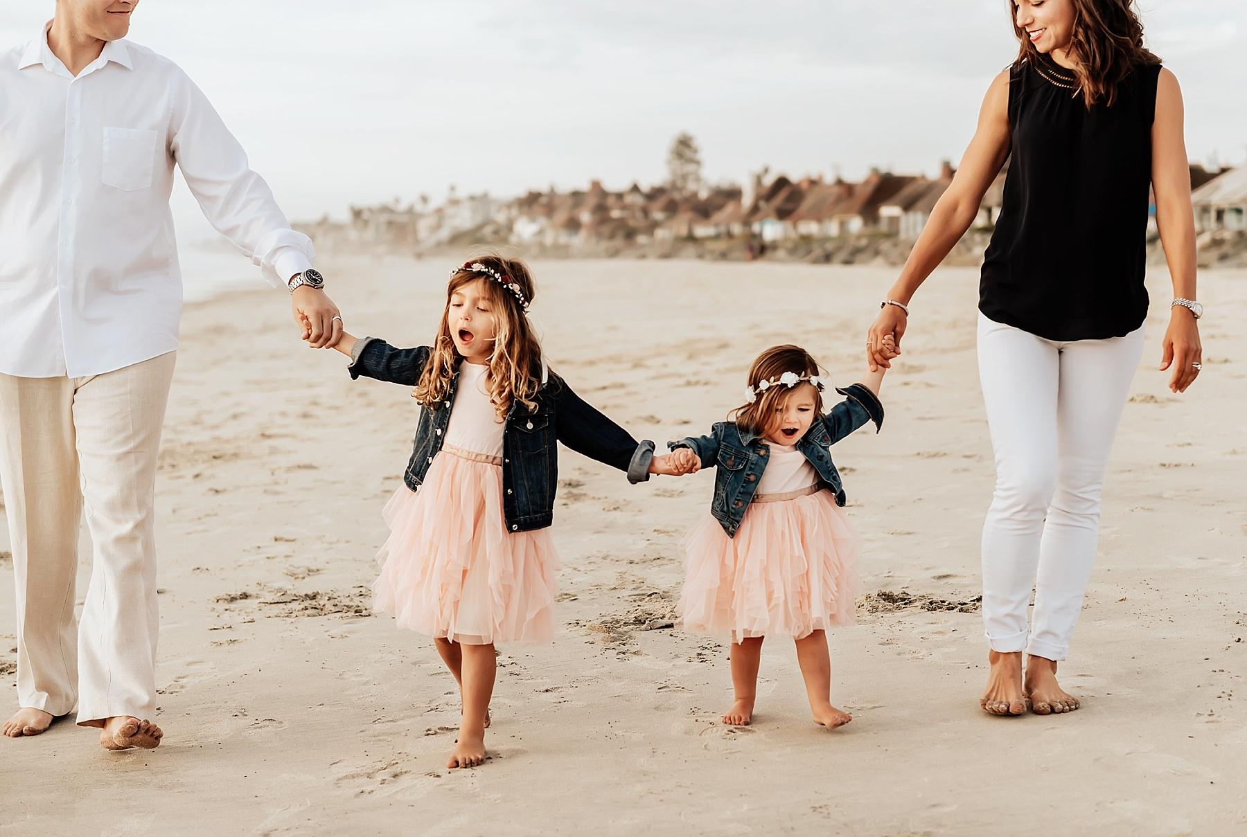 family beach portrait photography family of 4 walking on beach