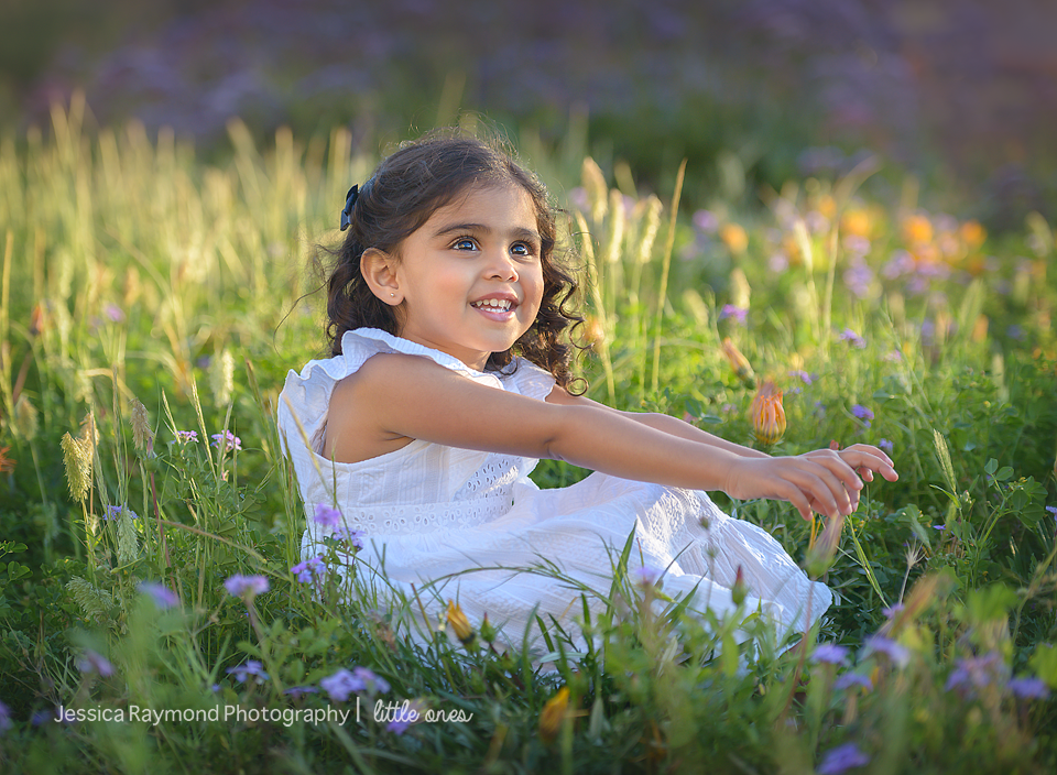 Child Photography Session Carlsbad Children's Photography Spring Portraits Girl Sitting In Flowers