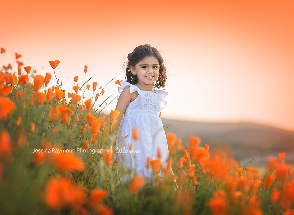 Child Photography Session Photography Session Spring Portraits Girl smiling in orange poppy field