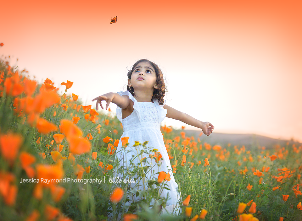 Child Photography Session Photography session Spring Portraits Girl In Flowers looking at butterfly