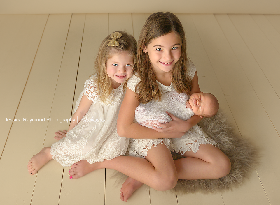 best newborn photo newborn sibling pose