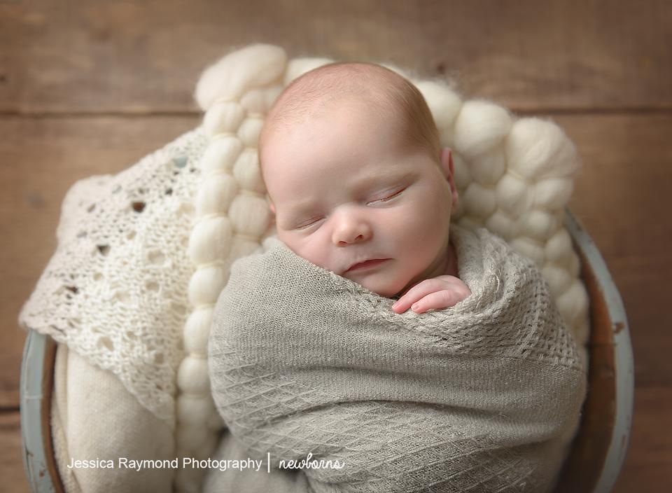 Newborn Photographer in San Diego newborn photography baby in blue bucket