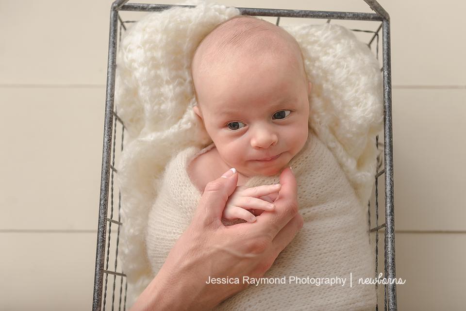 newborn photography studio session carlsbad california baby portraits baby boy in basket holding moms hand