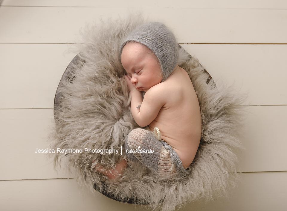 newborn photography studio session carlsbad california baby portraits baby boy in basket