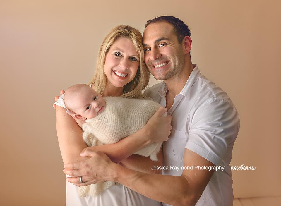 newborn photography studio session carlsbad california baby portraits parents holding baby boy