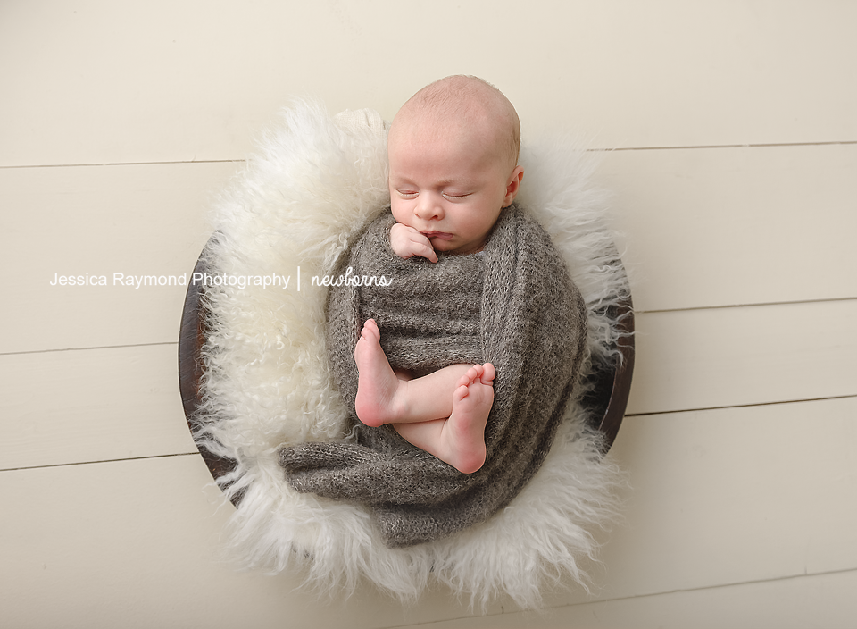 newborn photography studio session carlsbad california newborn session new born baby photography baby boy in basket with white fur