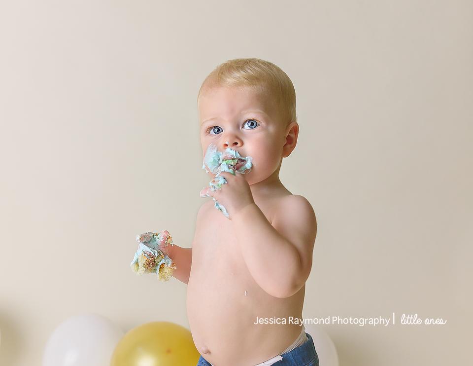 one year old portraits cake smash birthday session carlsbad california birthday boy eating cake