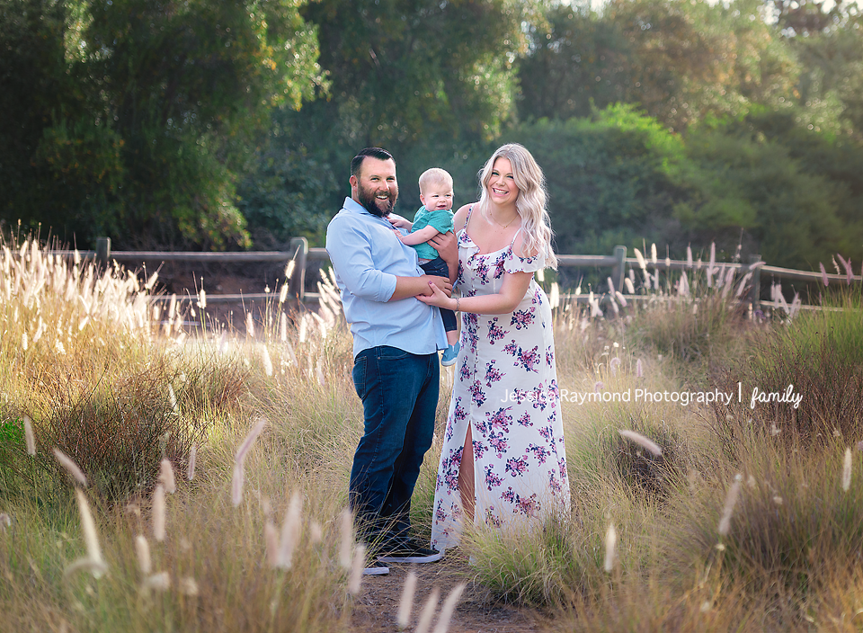 one year old portraits cake smash birthday session carlsbad california family picture in field