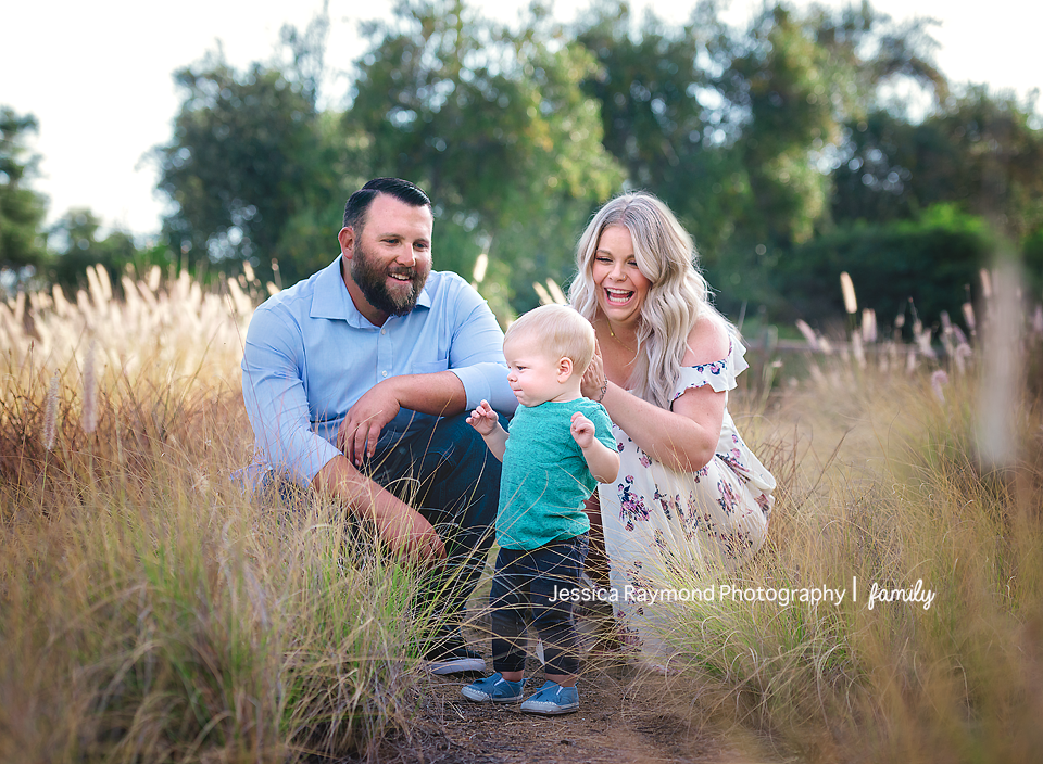 one year old portraits cake smash birthday session carlsbad california birthday boy dancing mom and dad laughing