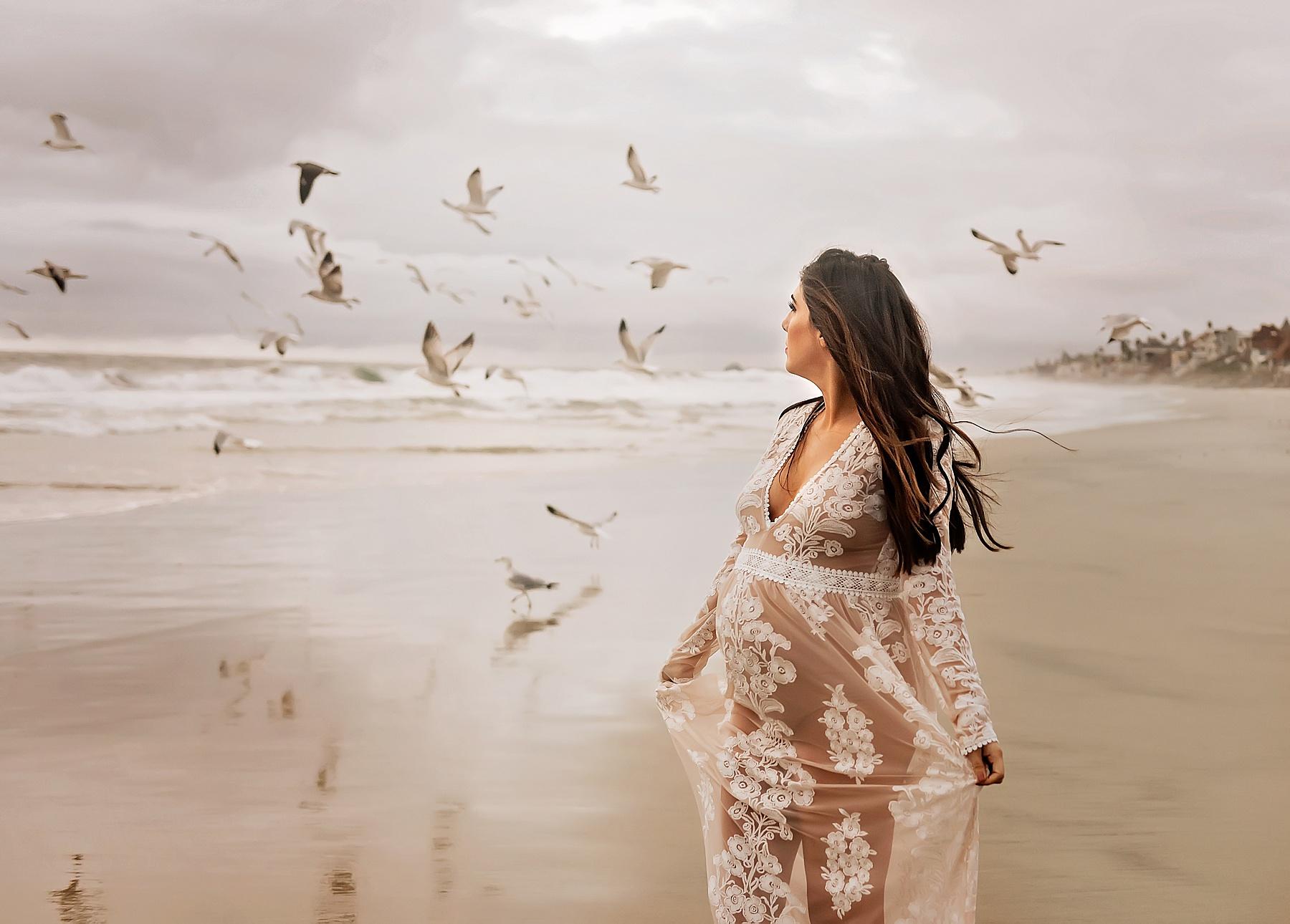 pregnancy beach photoshoot elegant pose