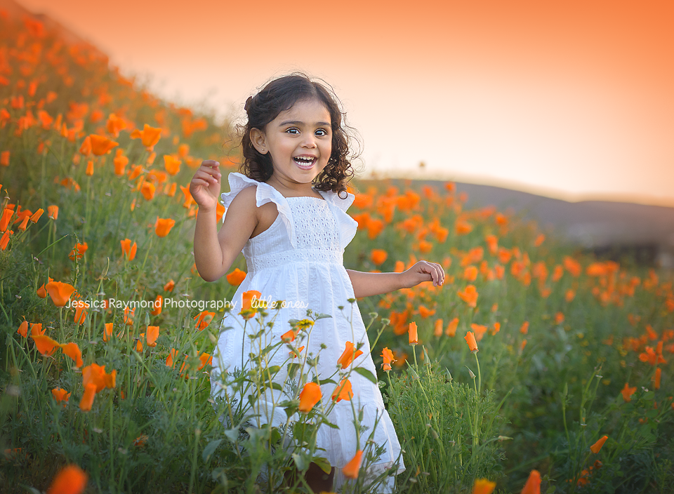 child photography session spring portraits carlsbad ca girl laughing in poppy field