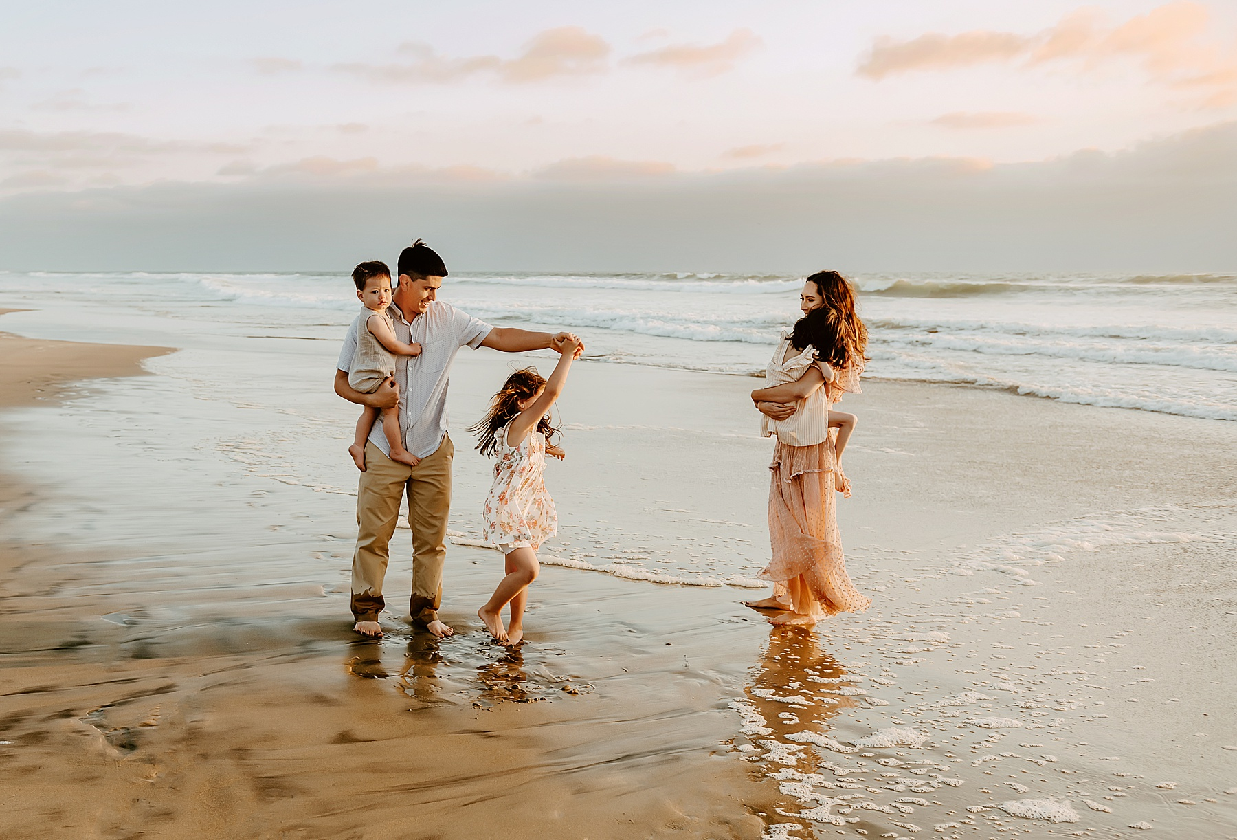 sunset family pictures del mar beach family dancing