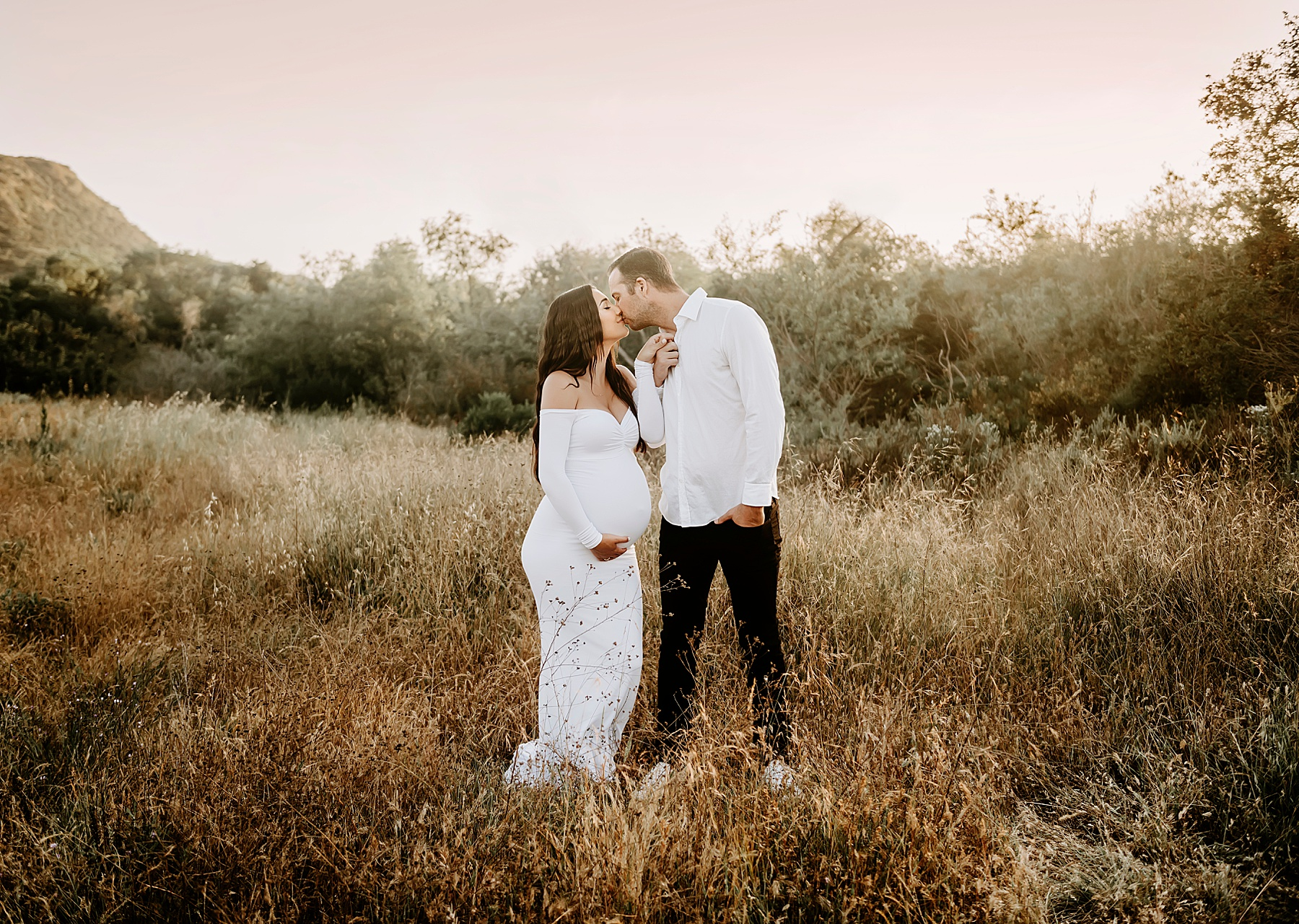 sunset field maternity session couple pose